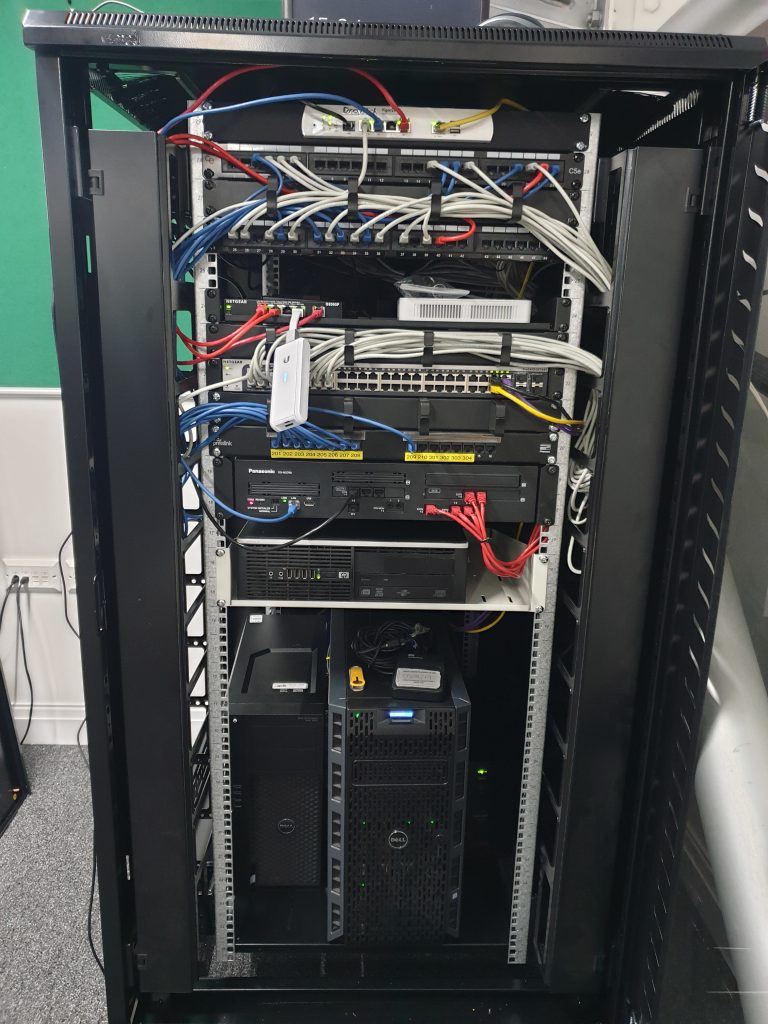 After image showing a medium sized comms cabinet with network infrastructure inside.