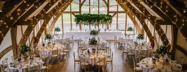 Interior of a function room at a wedding lit up by fairy lights